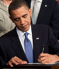 Obama signs healthcare bill